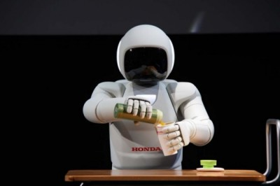 Honda's ASIMO robot  received cool new upgrades enabling it to move faster with better balance