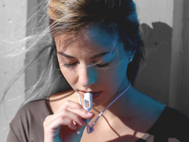 A MINI PORTABLE AIR PURIFIER NECKLACE YOU CAN WEAR ANYWHERE